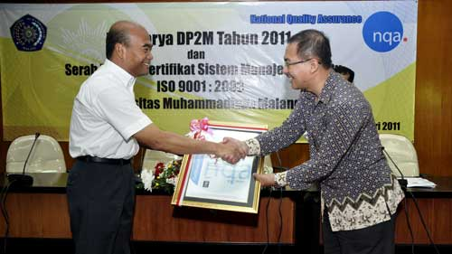 Handover of International Standard Organization (ISO) ISO 9001 version 2008 by Yayak A. Setyahadi to the
